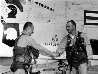 Click Photo to Enlarge. L-R CDR William Ecker Marine Capt John Hudson.